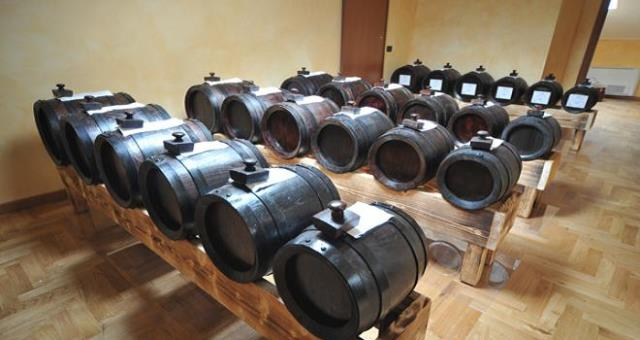 Balsamic vinegar the characteristic sweet and sour condiment historically produced in Modena and Reggio emilia provinces.
